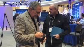 Arthur Blank Signing Autographs At Super Bowl LII