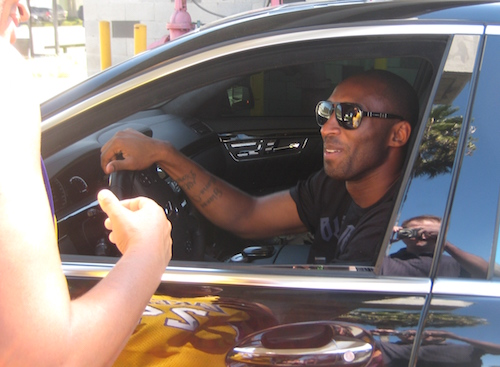 Kobe Bryant driving black Mercedes-Benz
