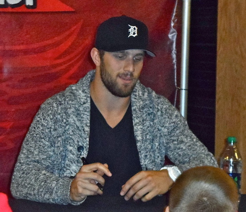 Riley Sheahan signing autographs