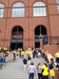 Michigan Stadium lists its capacity at just under 110,000 (largest football stadium in the US)