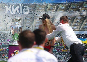 women remove shirts at Euro 2012 trophy protest