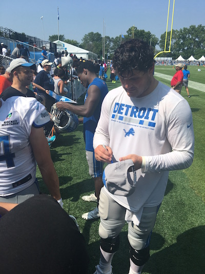 Anthony Zettel signing autographs at Lions training camp